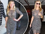 Twins! Kirsten Dunst steps out in the same sheer lacy dress that Rosie Huntington-Whiteley wore just one day earlier
