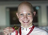 Gong: Great Britain's Joanna Rowsell holds up her gold medal after the Women's Individual Pursuit