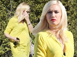 Something to talk about! 'Pregnant' Gwen Stefani can't hide the bloom as she steps out in a tummy-revealing yellow tunic