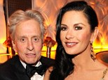In love: Michael Douglas and Catherine Zeta-Jones looked happy at in love earlier this year at the Vanity Fair Oscar Party