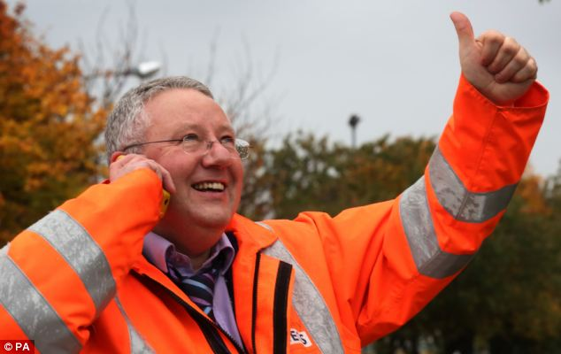 Delight: Worker Eddie Heaney celebrated after the announcement by owners Ineos to keep the Grangemouth petrochemical site open