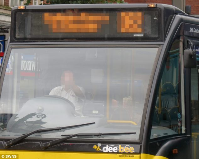 Rude: A gesturing driver captured by Mr Blakeway on September 28 in a GHA bus on Chester High Street