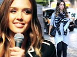 Jessica Alba drapes her slender frame in loose tunic... before lending her breathy vocals to music video