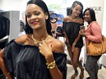 Rihanna meets fans at perfume launch before checking out the shops while flashing her pins in an off-the-shoulder playsuit