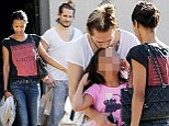 He's in with the family! Zoe Saldana's new husband Marco Perego showers her niece with affection