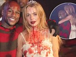 Hot property: Lindsay Lohan sneaks toyboy new squeeze into Halloween party but can't seem to get enough of engaged co-host Floyd Mayweather Jr