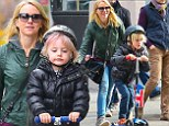 Naomi Watts' son Sammy debuts pink-streaked hair while scooting through Manhattan with brother Sasha