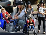 My little cutie! Jillian Michaels beams over son Phoenix as she turns trip to the Farmers Market into a fun family affair