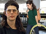 Marisa Tomei ditches the glamour as she goes make-up free for a flight out of Los Angeles