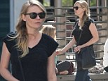 Cinema chic! Kirsten Dunst cuts a classy figure in black T-shirt and belted blue trousers for solo afternoon at the movies