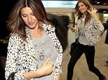 Purrrfect! Gisele celebrates her feline side in a Wild Instinct T-shirt and leopard print blazer as she jets out of Sao Paulo