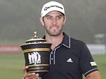 Hold on: Johnson poses with the Champions trophy after his remarkable final round in Shanghai