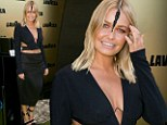 Australian model Lara Bingle looked stunning at Victoria Derby Day at the Melbourne Cup Carnival on Saturday in a midriff baring dress and unique headdress.