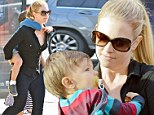 Muscle mum! Melissa Joan Hart gave her son Braydon a piggyback ride as she and the family left the Farmers Market in Studio City, California on Sunday
