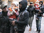 Chilling out! Alicia Keys and husband Swizz Beats don heavy clothes to beat the New York cold on family day out