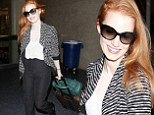 Pleasing to the red eye! Jessica Chastain looks stunning after flying into Los Angeles
