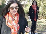 Catherine Zeta-Jones steps out in all-black outfit and orange print scarf amid rumours of a reconciliation with husband Michael Douglas
