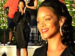 What a cover up! Rihanna is unusually demure in baggy belted black shirt and matching skirt for Barbados charity day