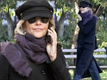 How about mixing it up a bit? Meg Ryan takes to the streets of New York in her favorite hat and coat ensemble