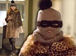 Now you see her, now you don't! Lily Cole peaks out from under grey balaclava as she heads out in leopard print coat