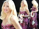 Aloha! Gwen Stefani spills out of her low-cut floral frock but covers up her 'pregnancy' bump at friend's party