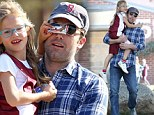 Doesn't that look good! Violet Affleck shields her father Ben's eyes with a candy bar as he takes her to her basketball game