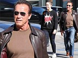 She's almost as tall as the Terminator! Arnold Schwarzenegger heads out to lunch with his Amazonian daughter Christina