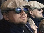 Can you even see the game? Undercover Leonardo DiCaprio watches football match in Paris wearing dark shades and his signature flat cap