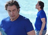 Is that a new weave? John Travolta sports lustrous hair and a paunch on set of his new film in Tahiti
