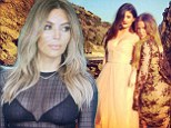 She just loves to show off that waist! Kim Kardashian reveals her trim post-pregnancy middle in a bra-baring sheer crop top and leather skirt for family shoot
