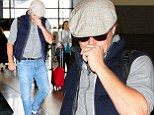 Leonardo DiCaprio keeps a low profile as he heads home after Hollywood movie gala