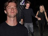 Sporty date night: Patrick Schwarzenegger, left, and his girlfriend Taylor Burns, right, attended a Los Angeles Lakers game at the Staples Centre in Los Angeles, California on Friday