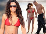 Mel B wows in red and gold bikini as she frolics on the beach with husband Stephen Belafonte