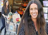 Spot the star! Alanis Morissette cuts a stylish figure at the grocery store in a polka dot shirt