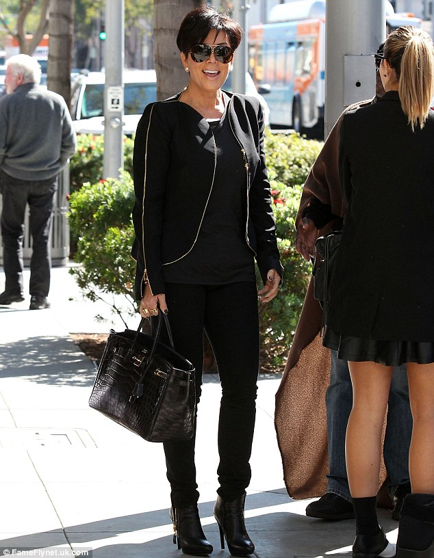 Charitable: The fabulous Kris was spotted in Beverly Hills last week handing over money to a homeless man