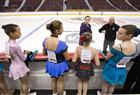 Skaters are given instructions as Skate Canada held on-ice auditions for 'flower retrievers'.