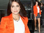 Nikki Reed shows off her long legs in tiny checked shorts and an eye-catching orange tuxedo jacket