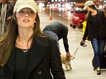 Minka Kelly is seen arriving at LAX airport with her cute pooch 'Chewy' in tow