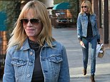 That's how to wear double denim! Brave Melanie Griffith pulls off fashion faux pas in slimline jeans and jacket
