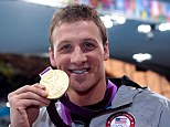 Injured: Ryan Lochte of the United States celebrates with his Gold Medal during the Medal Ceremony for the Men's 400m Individual Medley on Day 1 of the London 2012 Olympic Games