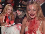 Lindsay Lohan learns how to party sober under watchful eye of Oprah's OWN team as she mingles with fans at Halloween bash