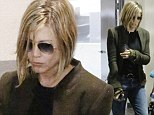 'I just got bored, honestly': Jennifer Aniston says she 'feels great' as she shows off new chopped-off blonde locks while running errands in her boyfriend jeans