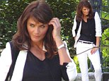 Not your average mom jeans! Helena Christensen shows she still has it in a monochromatic denim ensemble