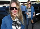 Kate Bosworth shows off her slender legs in skinny jeans as she jets out of LAX in style