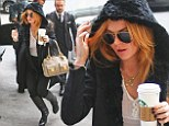 Lindsay Lohan goes braless in a sheer white top as she pops out for a mid-morning caffeine boost