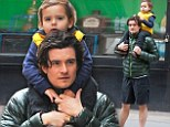 Just the two of us: Orlando Bloom hoists mini-me son Flynn on his shoulders during stroll as he becomes accustomed to life as a single father