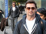 Pushing it: Hugh Jackman pushed a scooter on Tuesday in New York City as he walked to pick up his daughter from school