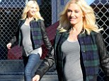 Her smile says it all! Pregnant Gwen Stefani is radiant as she shows off her baby bump on school run