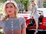 Hoping for a role in Mad Men? Holly Madison plays the damsel-in-distress as her classic car breaks down in Vegas