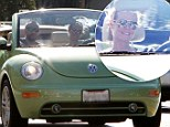 It's wheel love! Heidi Klum takes Martin Kristen for a spin in her convertible Beetle as the happy couple enjoy the sunshine